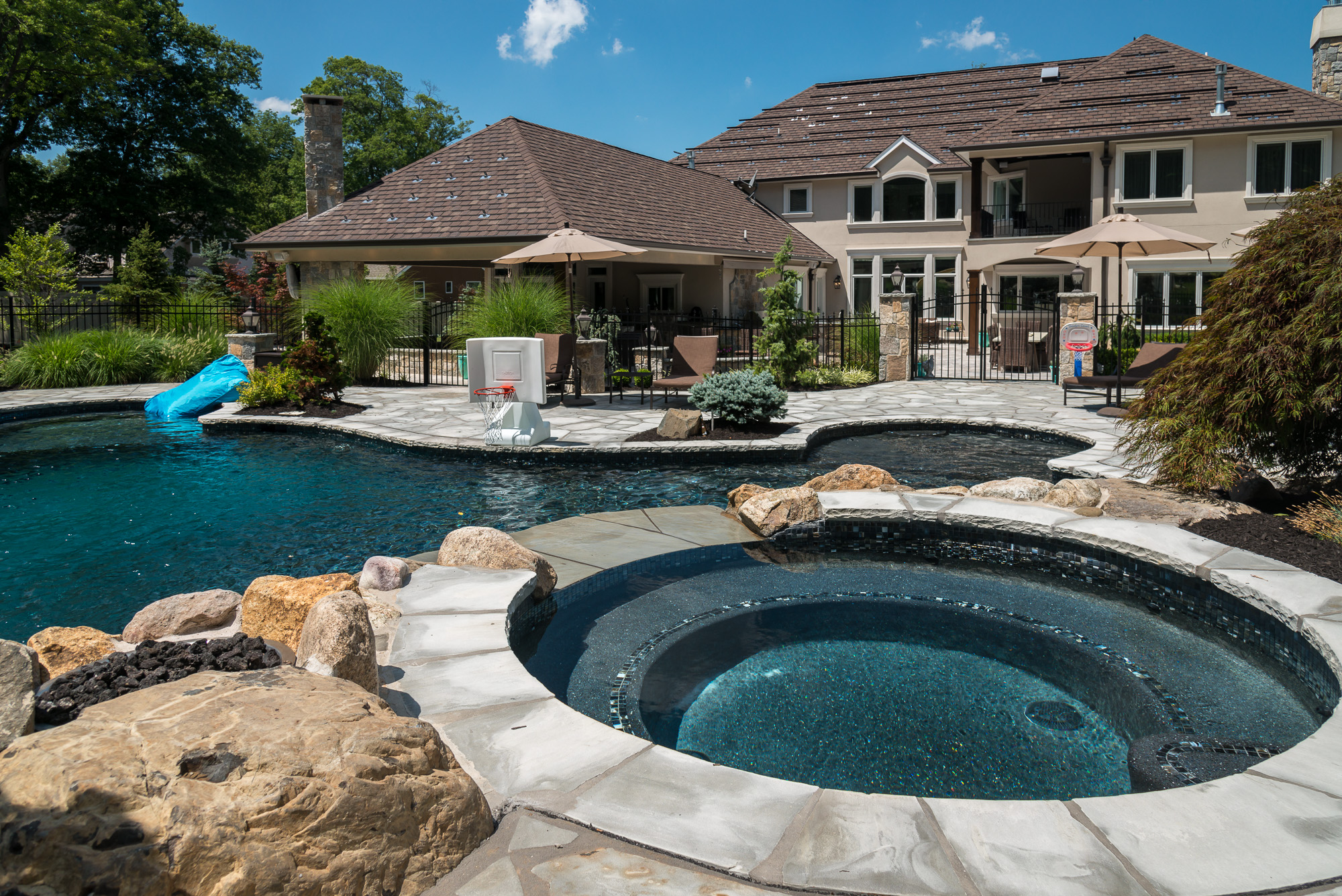 Livingston nj custom inground swimming pool design for Custom swimming pool designs