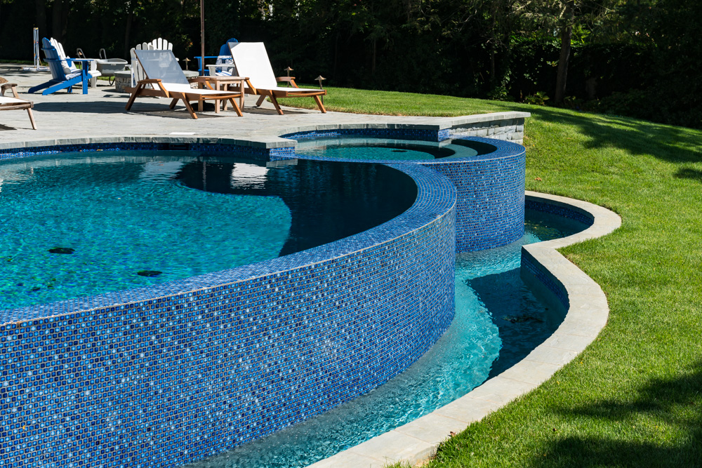 Pools by design vanishing edge pool new jersey for Inground swimming pool contractors